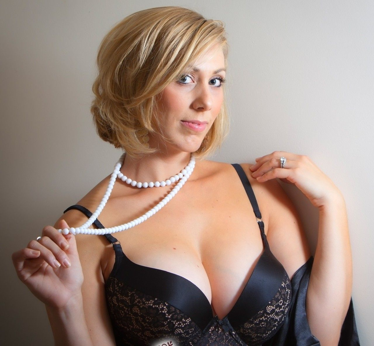 Busty woman in cafe stock photo